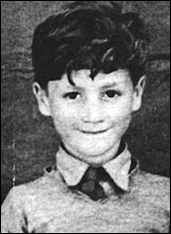 An impish-looking John Lennon during his childhood days in Liverpool, England.